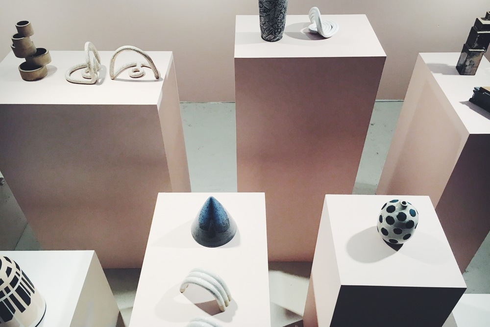 Uprise Art featuring a beautiful array of ceramic pieces and Chad Kouri paintings.