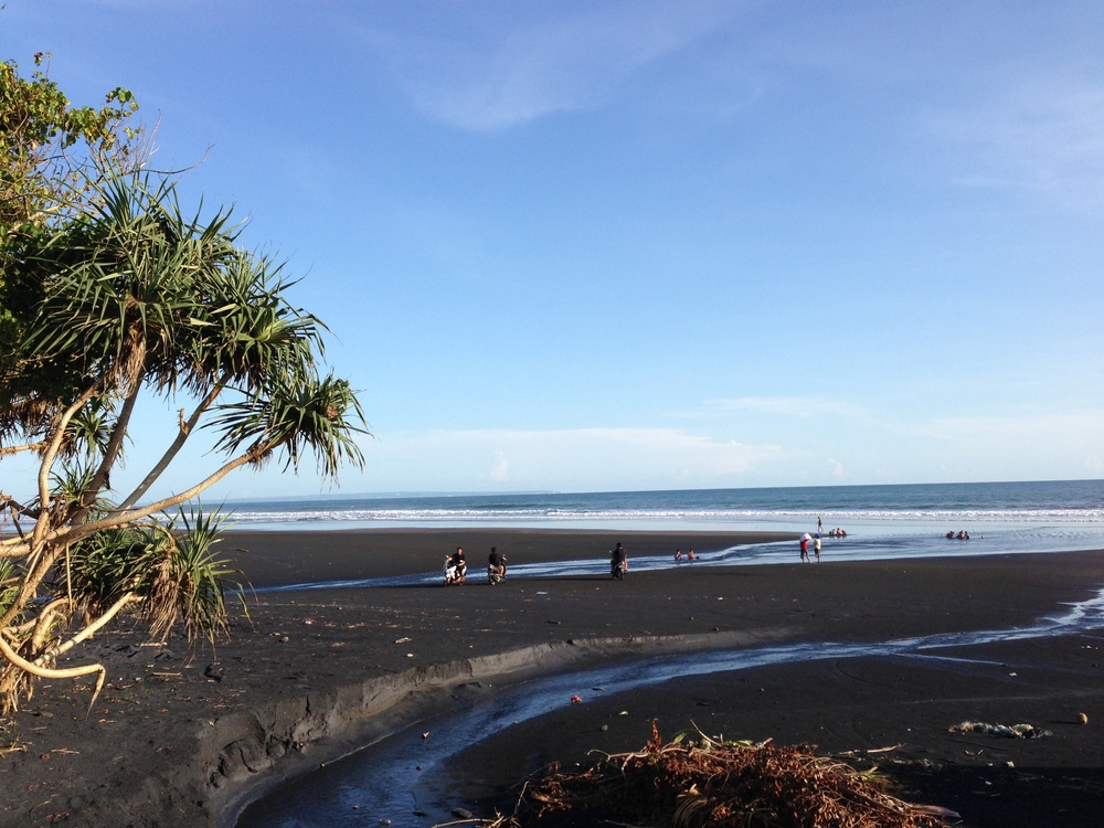 Just three hundred meters away from the rice field, it's a beach. Well, it has black sand but a beach nonetheless