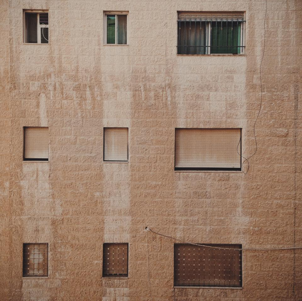 All buildings in Jordan are pretty much the same colour. Sandstone.