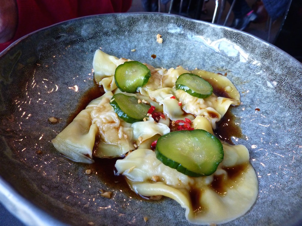 Delicate prawns dumplings with soy and pickle