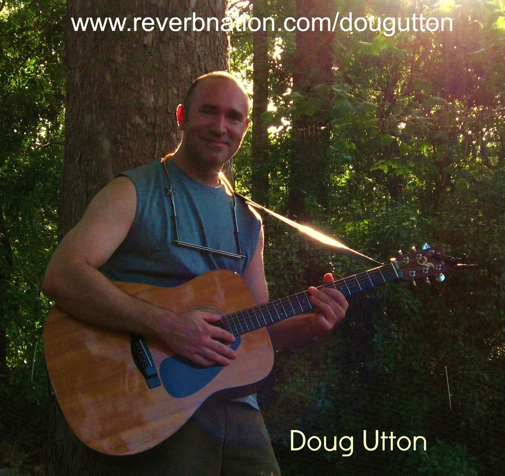 From the Green Mountains to Cape Fear, Doug has been sharing his original tunes and good vibes for the better part of two decades.  Born in Burlington, Vermont and raised in Essex Junction, Vermont, Doug enjoyed a fairly idyllic childhood with his parents and siblings; riding bikes, traipsing through the woods, and spending as much time on stage as he could possibly manage. He picked up the guitar and harmonica early in high school and began writing songs as soon as he could string three chords together. Bob Dylan was an early inspiration, and like Dylan, Doug's songs feature strong lyrics and characterization. After completing his B.A. in English and Film/Video at Middlebury College, Doug joined his family in their exodus to the more temperate neighborhood of Wilmington, North Carolina. In Wilmington Doug has entertained the patrons of the elegant Airlie Gardens and the earthy Ice House Beer Garden (alas no more! RIP), and took first place in the Cape Fear Folk Festival Songwriter's contest in 1996 and again in 2006. He has performed with Chesterfield Four; an electric roots blues combo, and Dead Man's Shoes; an acoustic rock duo with slide guitar master Dangerous Dave Thompson. 2009 saw the formation of Jus Woke Up; an electric rock and blues four-piece band. In 2011 Doug is back on stage with guitar and harmonica, rockin' it solo once again.