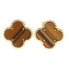 Van Cleef and Arpels Alhambra earrings in tiger's eye.