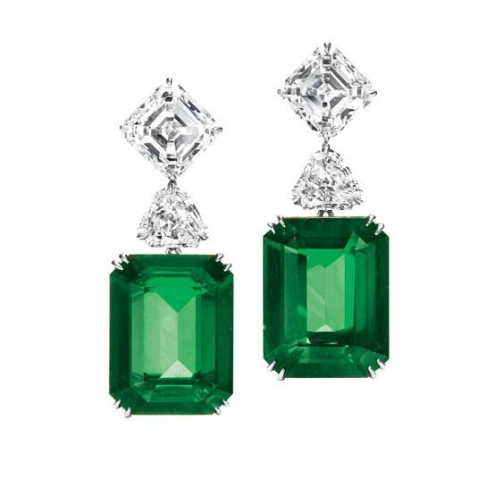 Harry Winston earrings in emerald, platinum, and diamond.