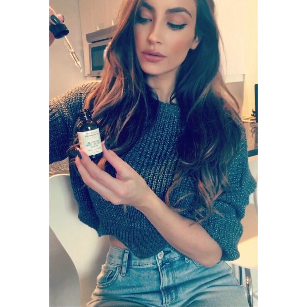Model Kelly Karloff using the Platinum Hyaluronic Serum