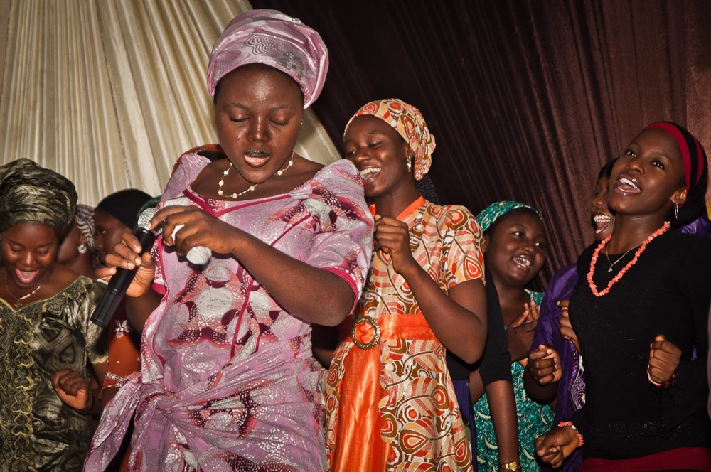 Church is a performance that includes singing and dancing and acting out of Bible-based melodramas and humorous skits.