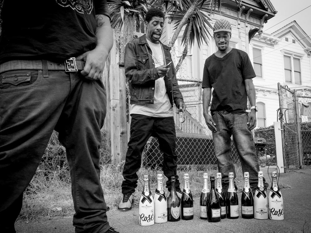 Champagne bottles symbolize wealth.