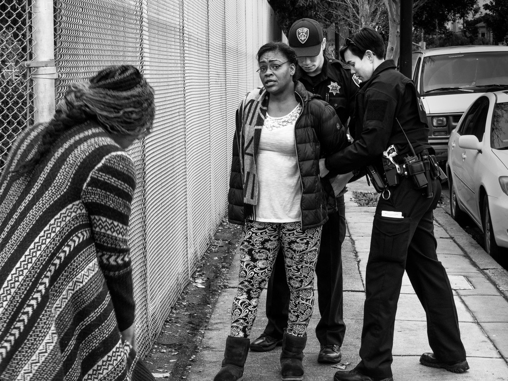 An arrest on the corner. The woman was certain the store had overcharged her credit card.