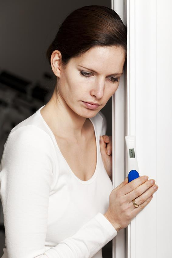 Sad woman with negative pregnancy test.jpg