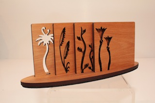 Ian Blackwell Rimu Native Flora Coaters $45 - 90mm x 90mm each and base 230mm x 60mm.