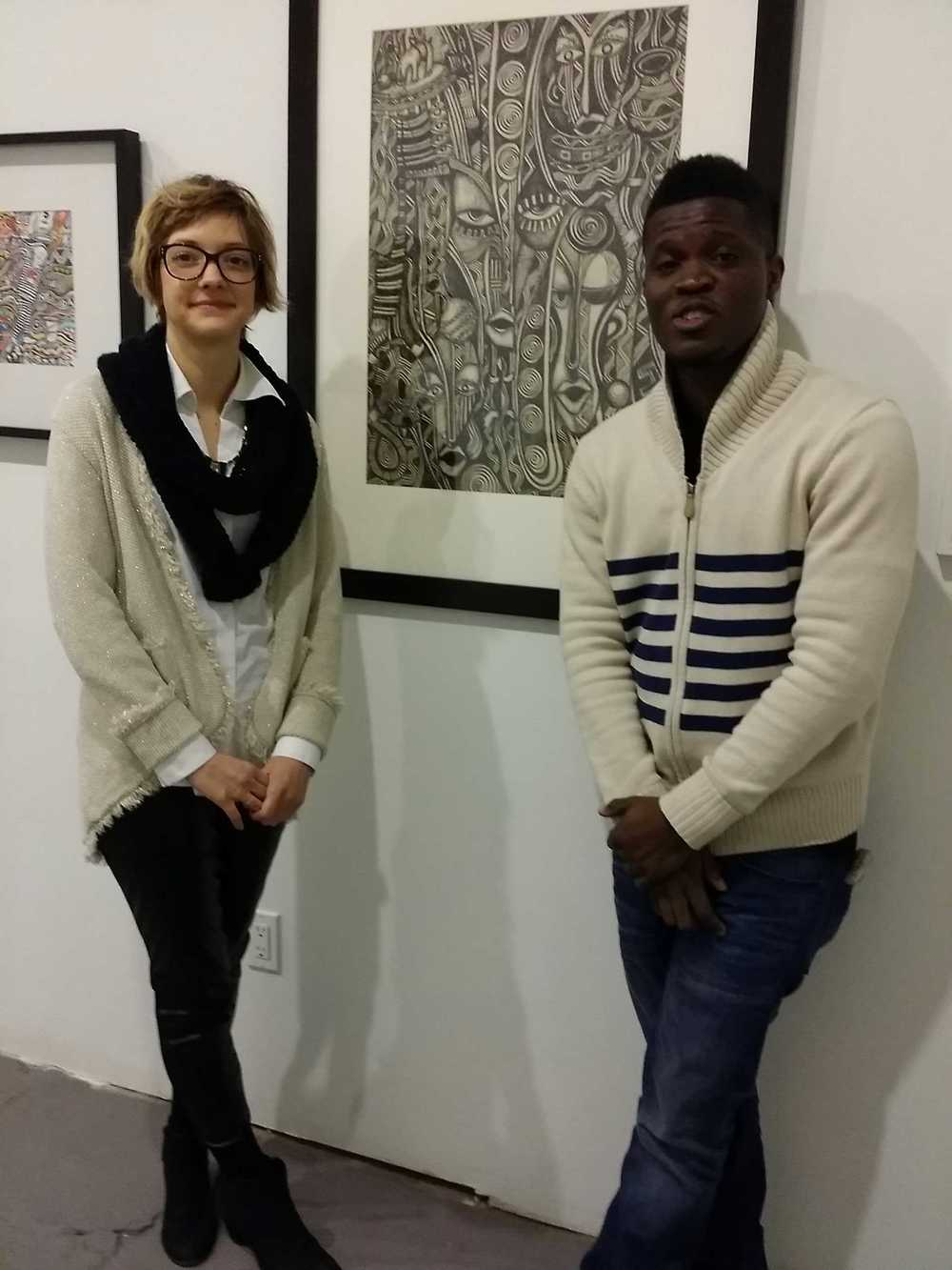 Laolu Senbanjo with Amos Eno Gallery Director, Hilary R. Whitham after hanging up  Masquerade.