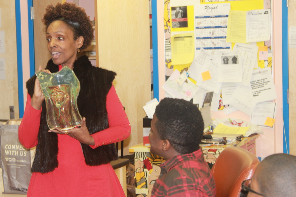 Barbara presenting Laolu with a Clay Piece which she sculpted herself.