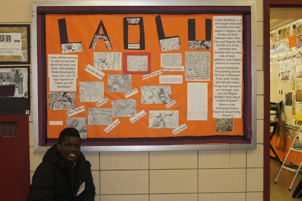 Laolu poses with beside Laolu.