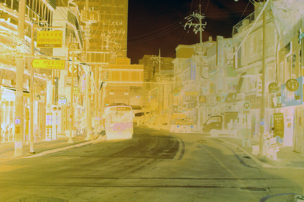 Negative film scan with color (no inversion) and contrast adjustment. I walked down this road to school every week while living in Korea.