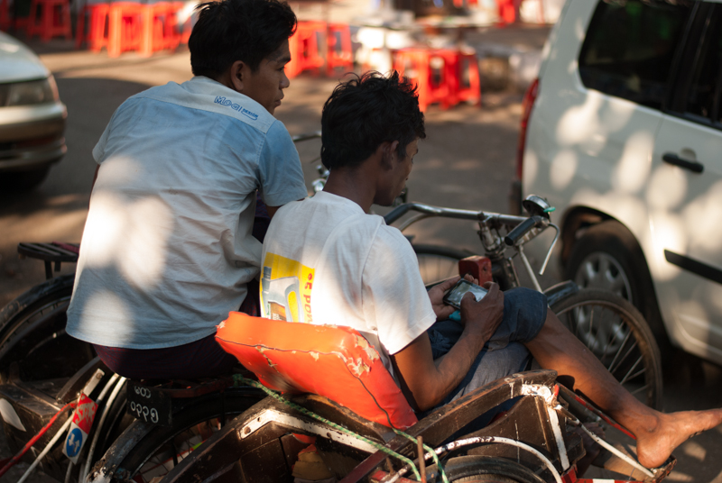 A man and his smartphone in the streets of Yangon