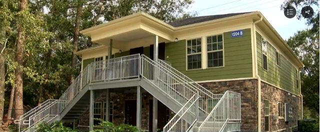 Carver Grove Apartments opened in October to provide housing for disabled veterans. Image Credit: WPDE ABC 15   10/18/2018 -  New Apartments Designed for Disabled Veterans Opens -  The Myrtle Beach Housing Authority, clients of Civitas, held a ribbon cutting ceremony in October 2018 for Carver Grove Apartments, a new complex designed specifically for disabled and homeless veterans. The complex includes eight one-bedroom units include first-floor units that are fully mobility accessible and second-floor units that include sensory adaptations for veterans with sight or hearing impairments. As a veteran-owned firm, Civitas has a special interest in expanding care for the men and women who have served in the military. We are proud to work towards ending veteran homelessness. ( Link )
