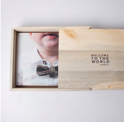 WOODEN BOX The perfect home for your photo books or prints. Our wooden box features a customizable printed lid with your choice of text or an image. Best part? The box is handcrafted with reclaimed mountain beetle pine.