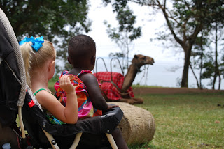 One of the crazy camels, Lake Victoria, and our beautiful baby girls!