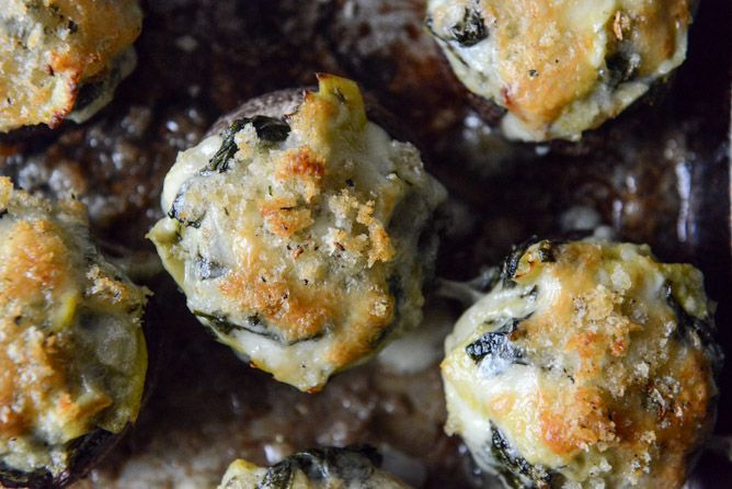 Spinach, Bacon and Artichoke Stuffed Mushrooms - recipe from How Sweet Eats