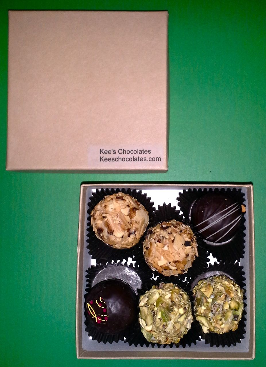 White chocolate almond, white chocolate pistachio, dark chocolate black rose and dark chocolate Earl Grey