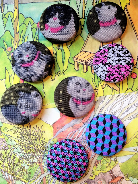 2. Set of cat buttons, made from an old knit shirt. Though I quickly learned that stretching printed knits over buttons results in neurotic cat faces. I'll stick to woven fabric for the next batch.