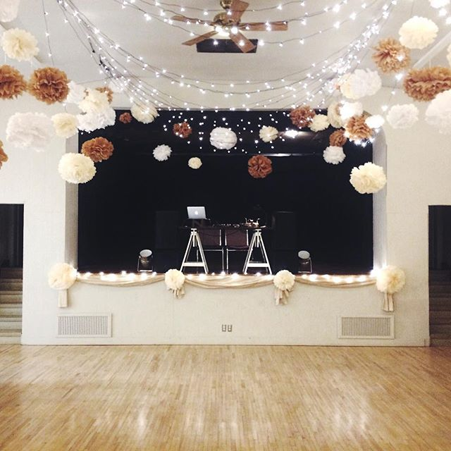 CUTE VENUE ALERT!  Bonnie Doon Hall dressed up with string lights and paper pom poms. Has a retro school dance vibe!  #yegwedding #yegwed #yegweddings #yegevents #claireisthenewblack