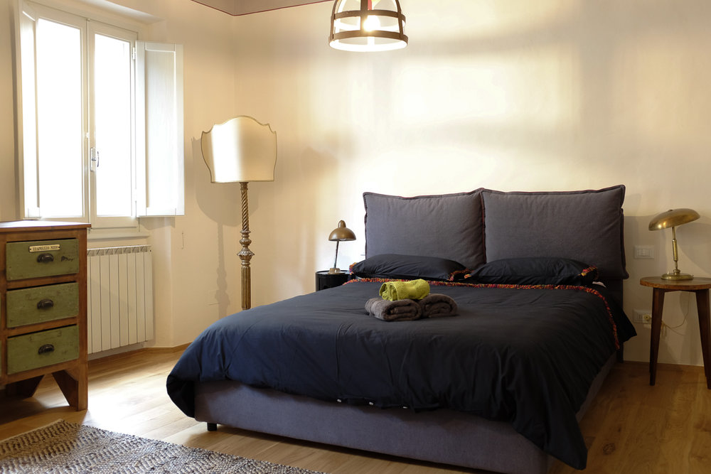 The master bedroom is spacious. The bed is 160cm width by 200 cm long. Windows are double pained for noise insulation.