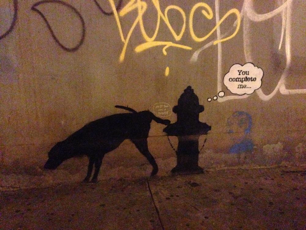 Banksy graffiti on 24th Street and 6th Avenue in Manhattan.
