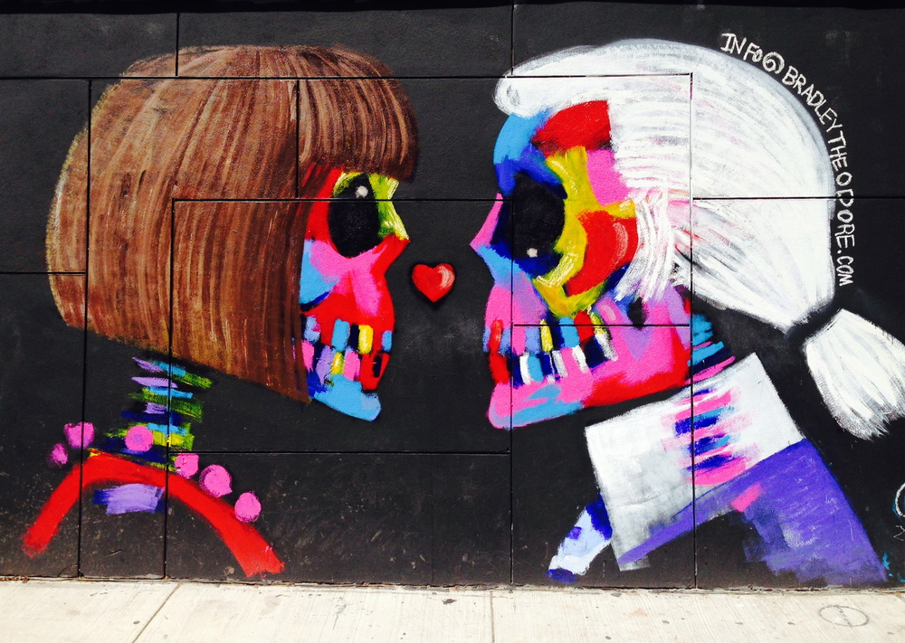 "Anna and Karl (on the corner of Kenmare and Elizabeth in Soho) by artist  Bradley Theodore , who says:  ""'Fashion allows people to become art[.}'"""