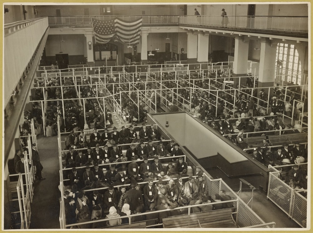 When the Great Hall was called the Registry Room in the early 1900s. The people in the pens have passed the first mental inspection. (Photo by Edwin Levick /  NY Public Library Digital Collection )