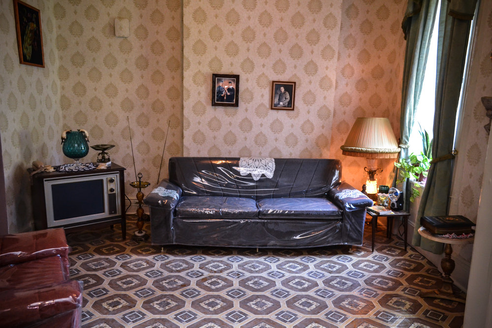 The living room of Ramonita Saez and her two children. (Photo courtesy of the Tenement Museum.)
