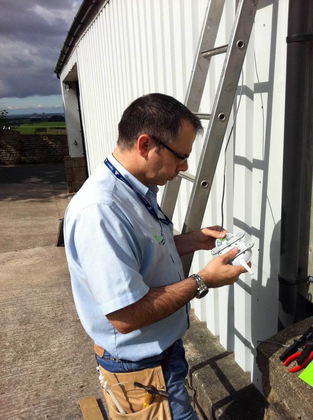 Mike Dent installing Meraki repeater