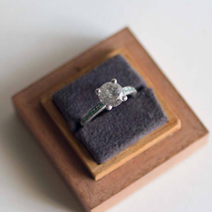 Custom KABEER ring with a 1.25 carat galaxy diamond set in platinum with rare natural paraiba tourmalines.