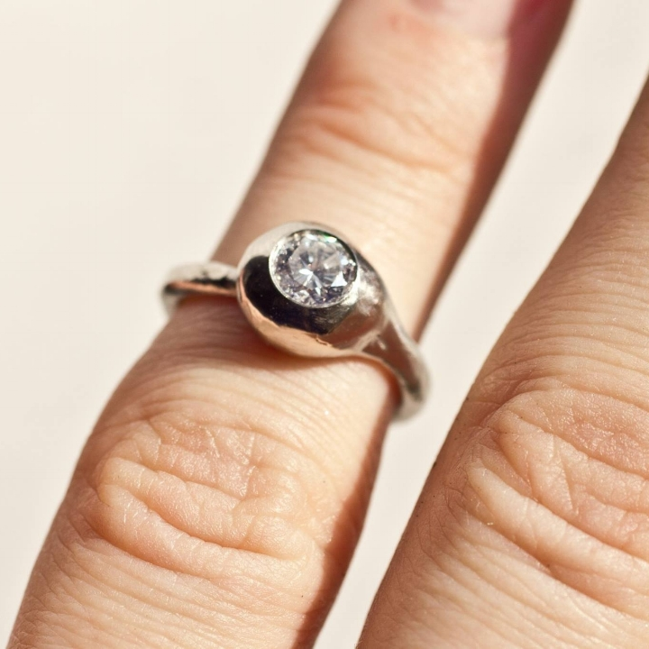 Design based on  Ouroboros . Diamond was a family heirloom.
