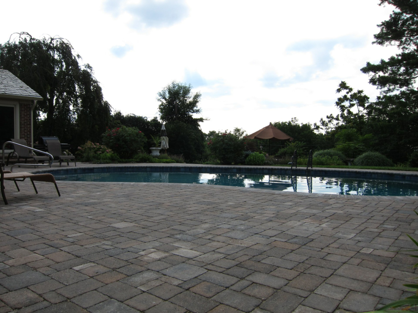Tri-State project with Dublin Cobble paver deck in Sheffield Blend color range.  Bullnose Paver Coping, Sable Blend.  Mosaic waterline tile and Diamond Brite interior finish.