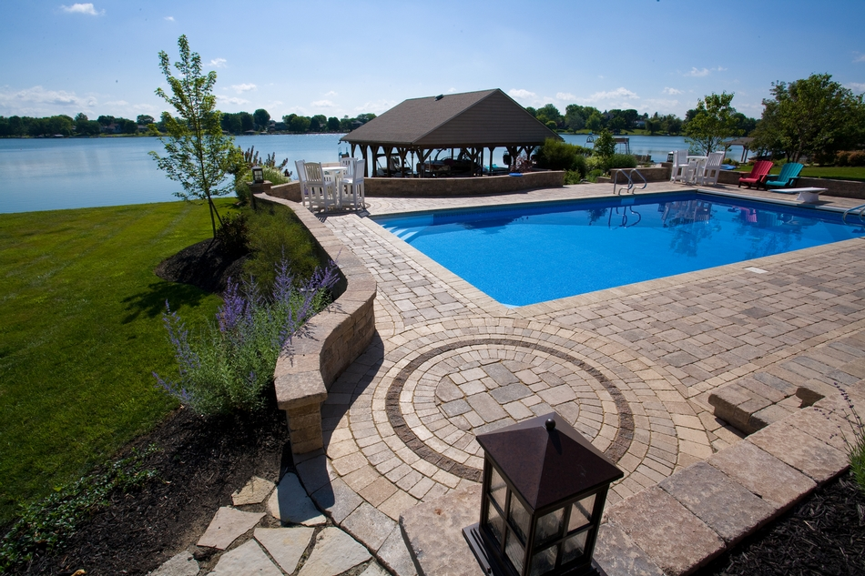 "Unilocks' Brussels Block® is one of the original ""tumbled"" pavers. The appeal of Brussels Block is its timeless warmth, beauty and relaxed appearance.  The XL stone or Bullnose Paver looks great as a matching pool coping."