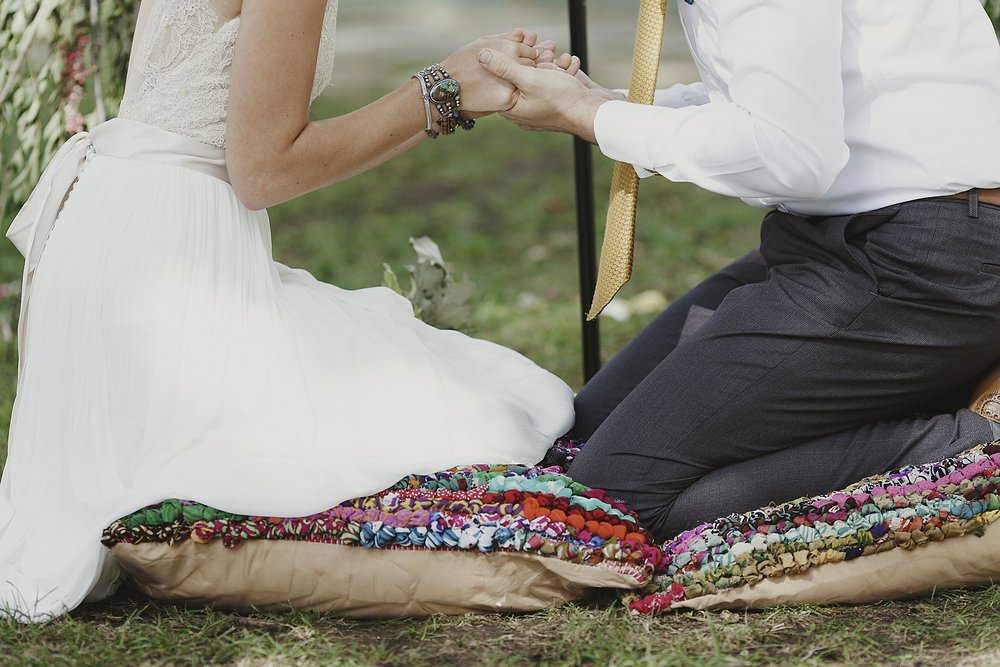 boho-wedding-ceremony-kneeling