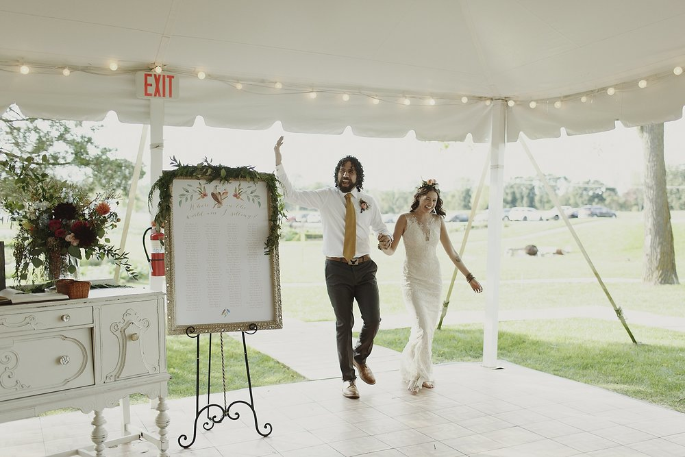 bride-and-groom-reception-entrance-tent