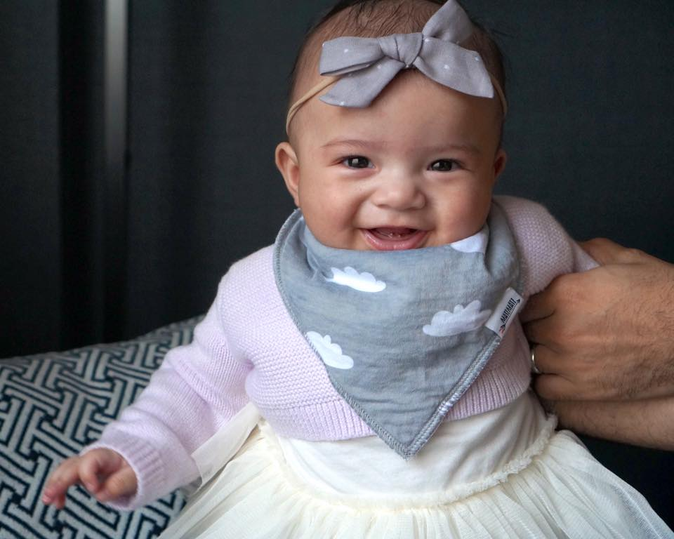 4 Months Old  Headband:  Little Poppy Co ; Drool Bandana:  Matimati Baby ; Cardigan: Gap; Tutu Bodysuit:  Gap