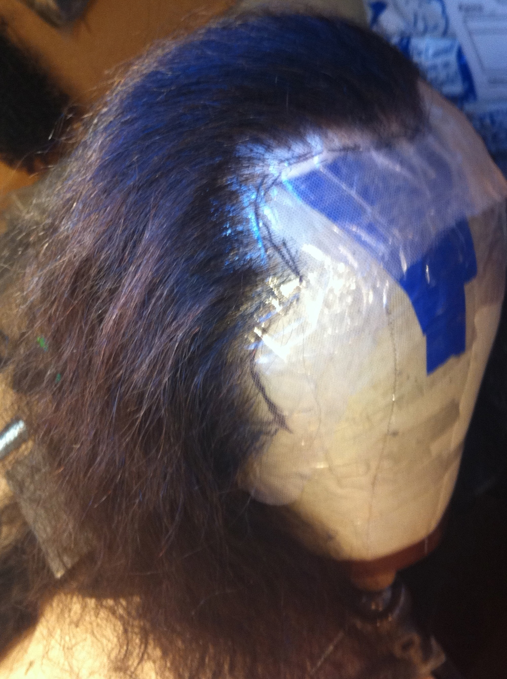 Fully hand-tied wig in process.