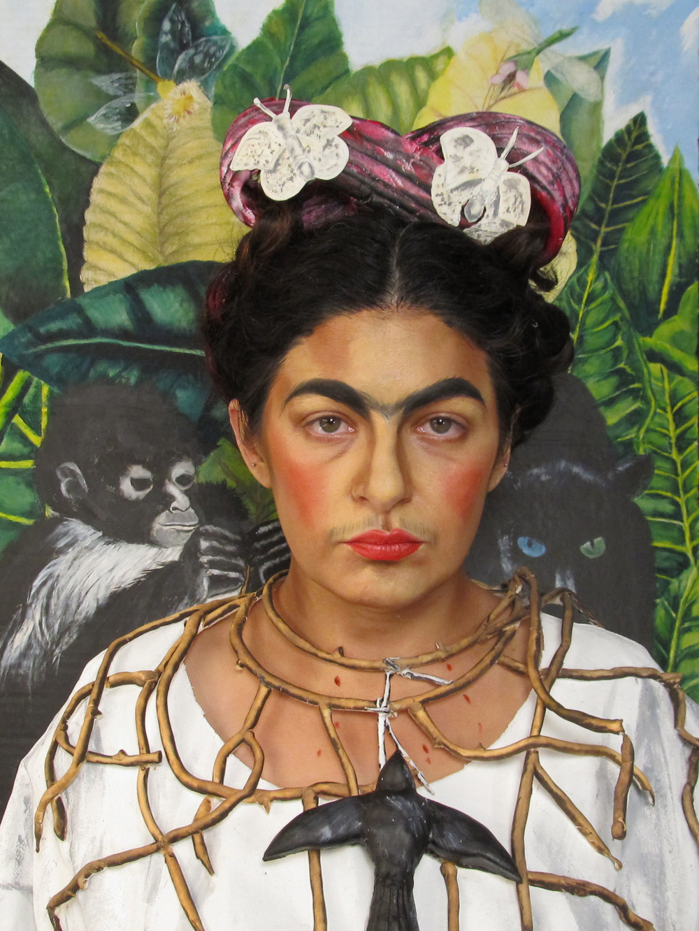 3D painting interpretation of Frida Kahlo's Self Portrait with Thorn Necklace and Hummingbird.