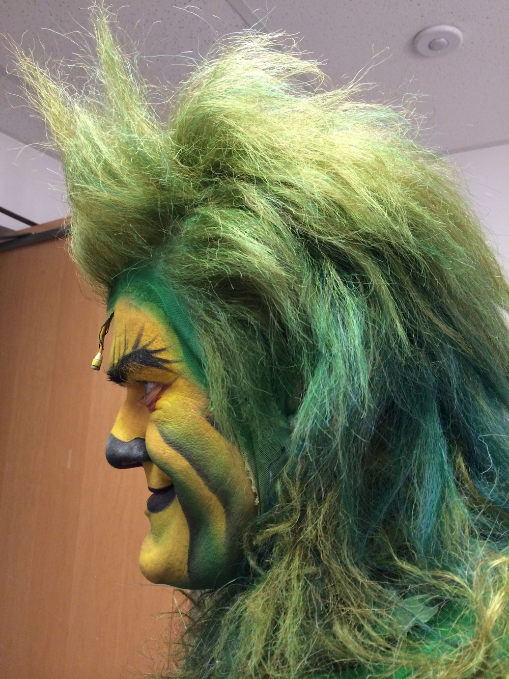 Close up of the Grinch makeup.