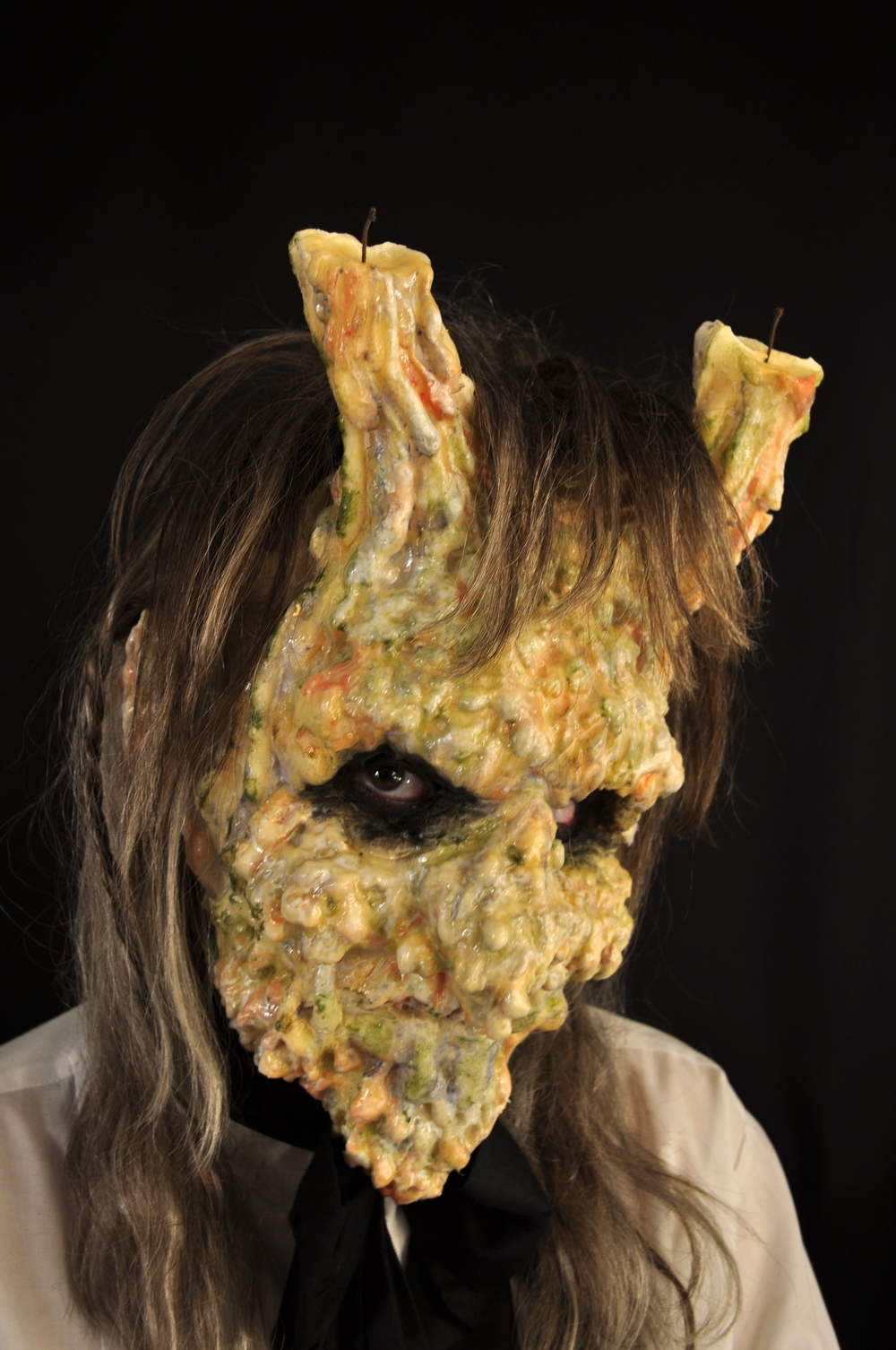 Candle Wax Monster   Six piece urethane foam prosthetic with pax paint and synthetic styled wig.   Photo by  Mazena Puksto