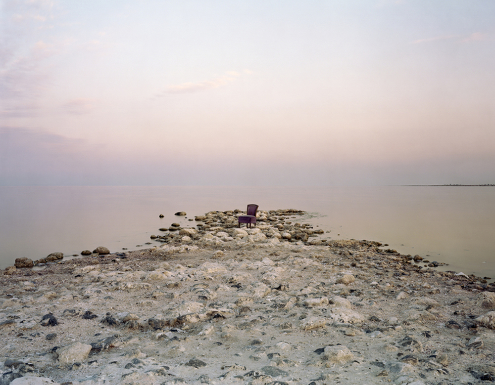 Pink Chair, Salton Sea Beach, 2013    The Salton Sea is located on one of the most important flyways in North America, providing critical habitat for more than 400 species of resident and migrating birds. As water elevation continues to decline and salinity continues to increase, the resulting degeneration in the habitat the birds and fish depend on would cause an eventual collapse of the fishery.  Salinity in the sea is currently 30% higher than the ocean.