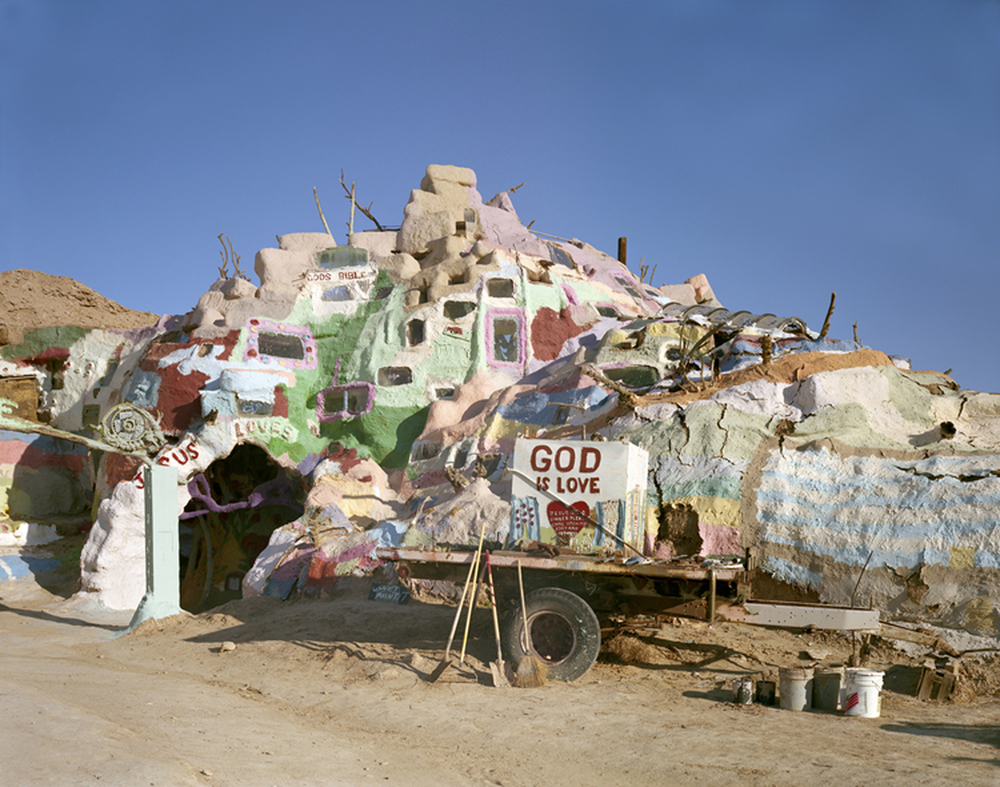 Salvation Mountain, Colorado Desert, CA, 2013    Vermonter Leonard Knight (1931-2014) eventually settled in the Colorado Desert at the entrance to Slab City and devoted 27 years to building this straw and adobe structure covered with, by his own estimation, thousands of gallons of paint.  An homage to his religious conversion and desire to spread the gospel, Salvation Mountain has become a pilgrimage site for the devout as well as the merely curious.