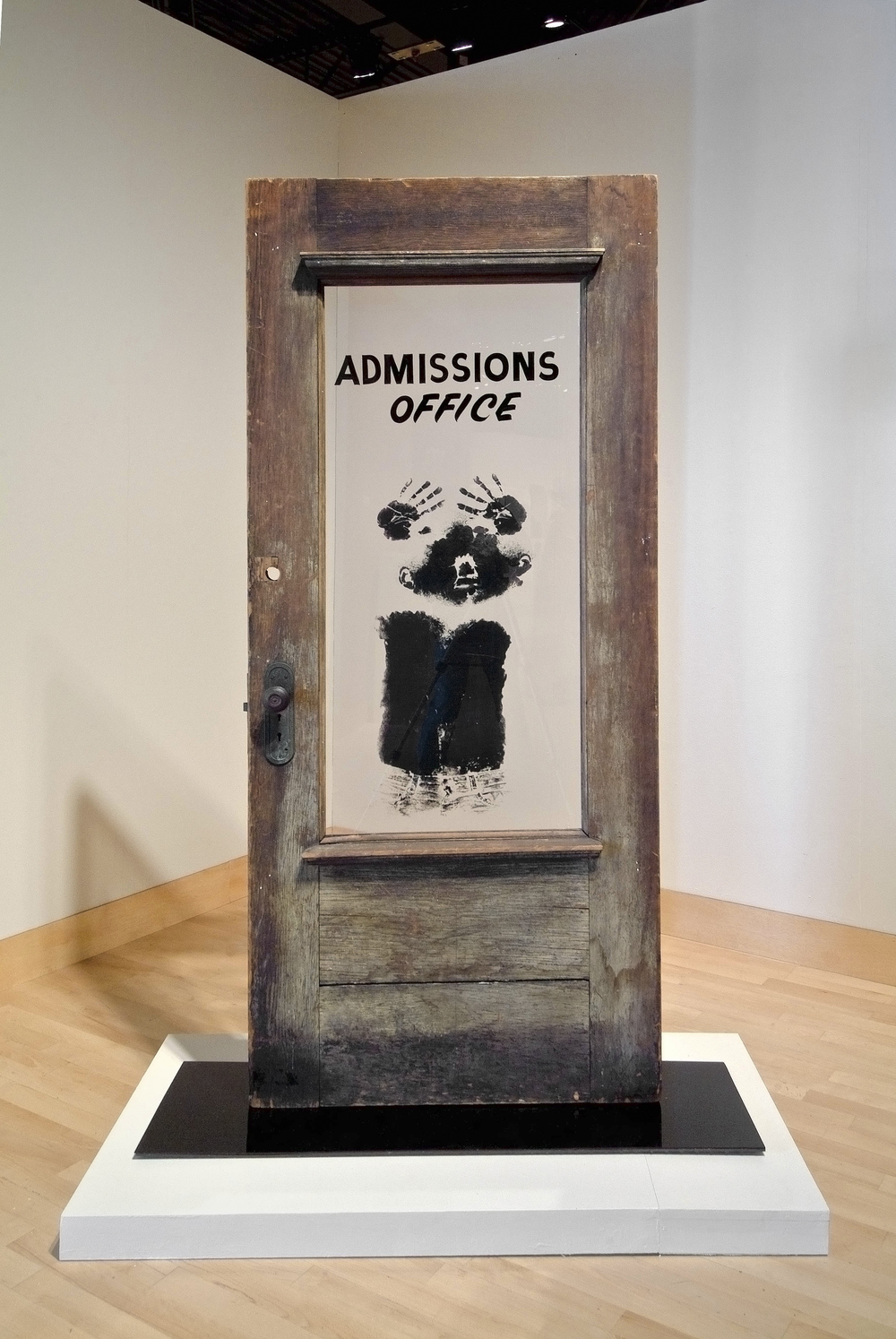 David Hammons (American, born 1943). The Door (Admissions Office), 1969. Wood, acrylic sheet, and pigment construction, 79 x 48 x 15 in. (200.7 x 122 x 38.1 cm). California African American Museum, Los Angeles, Collection of Friends, the Foundation of the California African American Museum. © David Hammons   Witness: Art and Civil Rights in the Sixties is organized by the Brooklyn Museum