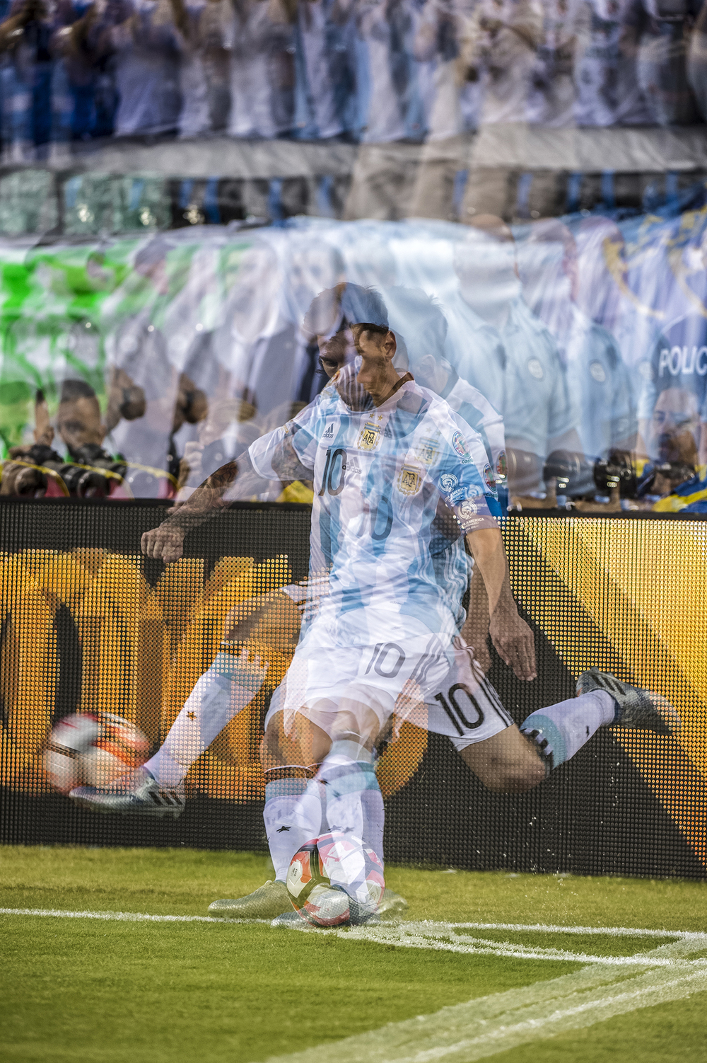 In camera Multiple exposure of Leo Messi during a corner kick.  Nikon D4s 200-400mm f4.  Lean against the video board to hold a still as possible.
