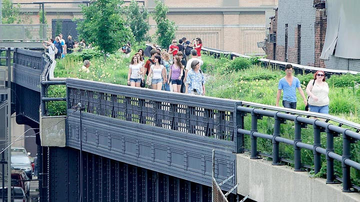 New York's High Line park, seen here in 2011, has become one of the top visitor attractions in the city. The popular park was built along an abandoned elevated train line in Manhattan. (Kathy Willens / Associated Press)