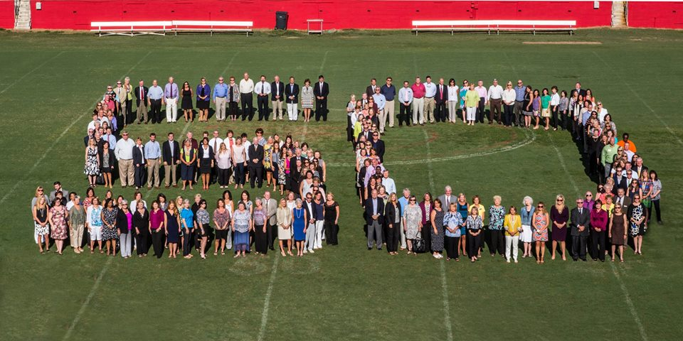 Berkshire Hathaway C. Dan Joyner REALTORS Celebrate 50 Year Anniversary - Group Shot at Sirrine Stadium
