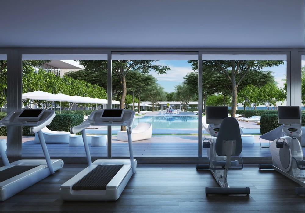 Gym overlooking pool area