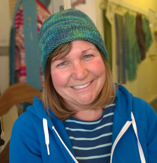 Here is Cindi Toledo with her first ever finished project! A cute basic hat, knit out of Encore worsted.